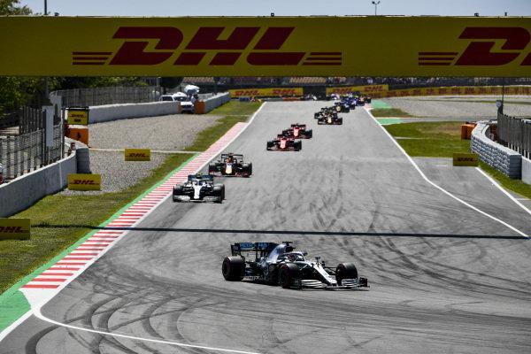 Lewis Hamilton, Mercedes AMG F1 W10, leads Valtteri Bottas, Mercedes AMG W10, Max Verstappen, Red Bull Racing RB15, Sebastian Vettel, Ferrari SF90, and Charles Leclerc, Ferrari SF90