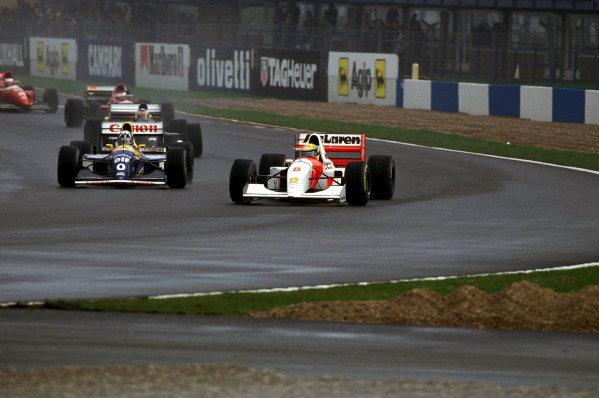 Ayrton Senna, McLaren MP4-8 Ford, leads Damon Hill, Williams FW15C Renault.