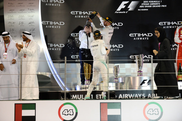 Nico Rosberg (GER) Mercedes AMG F1, Lewis Hamilton (GBR) Mercedes AMG F1 and Kimi Raikkonen (FIN) Ferrari celebrate on the podium at Formula One World Championship, Rd19, Abu Dhabi Grand Prix, Race, Yas Marina Circuit, Abu Dhabi, UAE, Sunday 29 November 2015.