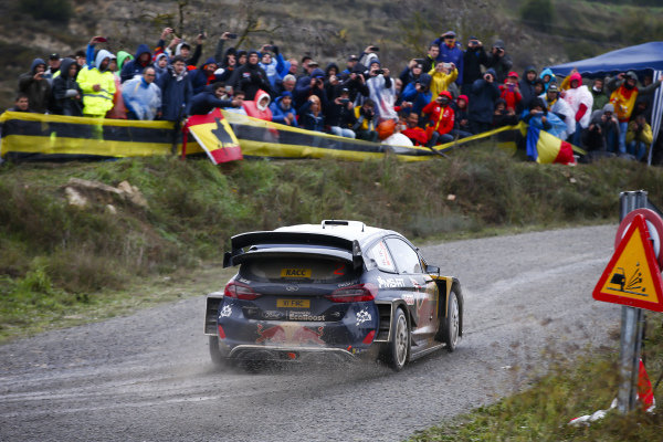 Elfyn Evans, M-Sport Ford, Ford Fiesta WRC 2018, sprays some loose gravel covering the asphalt.