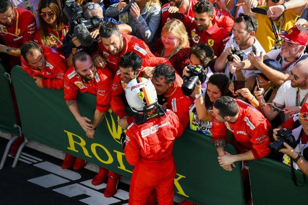 Sebastian Vettel, Ferrari, 3rd position, celebrates with his team in Parc Ferme