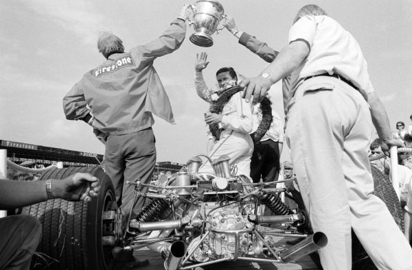 Jim Clark, on his Lotus 49 Ford, waves on his parade lap after the race.