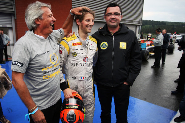 Roman Grosjean (FRA) DAMS celebrates his third place and GP2 Title with Eric Boullier (FRA) Lotus Renault GP Team Principal and Jean-Paul Driot (FRA) DAMS Boss. GP2 Series, Rd 8, Race 1, Spa-Francorchamps, Saturday 27 August 2011.