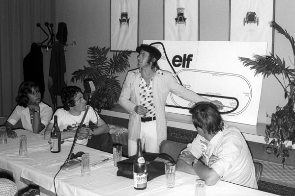 (L to R): Jackie Stewart (GBR) describes the Monza circuit to journalists as tenth placed Patrick Depailler (FRA) Tyrrell (Left) watches on.Italian Grand Prix, Rd13, Monza, Italy, 8 September 1974.