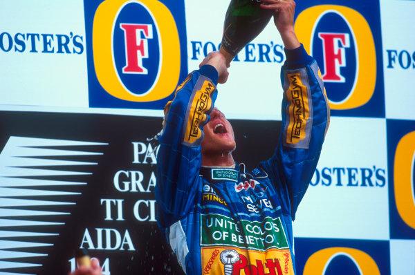 Tanaka International, Aida, Japan.15-17 April 1994.Michael Schumacher (Benetton Ford) celebrates 1st position on the podium.Ref-94 PAC 08.World Copyright - LAT Photographic