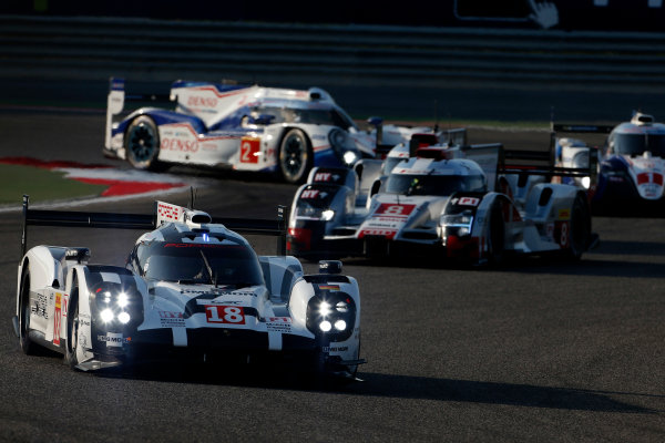 2015 FIA World Endurance Championship Bahrain 6-Hours Bahrain International Circuit, Bahrain Saturday 21 November 2015. Romain Dumas, Neel Jani, Marc Lieb (#18 LMP1 Porsche AG Porsche 919 Hybrid) leads Lucas Di Grassi, Lo?c Duval, Oliver Jarvis (#8 LMP1 Audi Sport Team Joest Audi R18 e-tron quattro), Anthony Davidson, S?bastien Buemi, Kazuki Nakajima (#1 LMP1 Toyota Racing Toyota TS 040 Hybrid) and Alexander Wurz, St?phane Sarrazin, Mike Conway (#2 LMP1 Toyota Racing Toyota TS 040 Hybrid). World Copyright: Alastair Staley/LAT Photographic ref: Digital Image _79P0127
