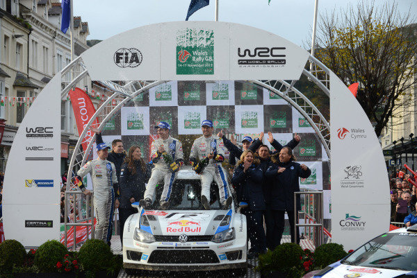 Rally winners Sebastien Ogier (FRA) and Julien Ingrassia (FRA), VW Polo R WRC on the podium. FIA World Rally Championship, Rd13, Wales Rally GB, Deeside, Wales, Day Three, Sunday 17 November 2013.