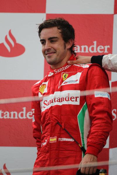 Circuit de Catalunya, Barcelona, Spain13th May 2012Fernando Alonso, Ferrari, 2nd position, celebrates on the podium. World Copyright: Andy Hone/LAT Photographicref: Digital Image HONY9213