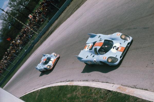 Monza, Italy. 25th April 1971. Rd 5.Pedro Rodriguez/Jackie Oliver, Porsche 917k, 1st position leads Jo Siffert/Derek Bell, Porsche 917K, 2nd position, action.World Copyright - LAT PhotographicRef: 4652