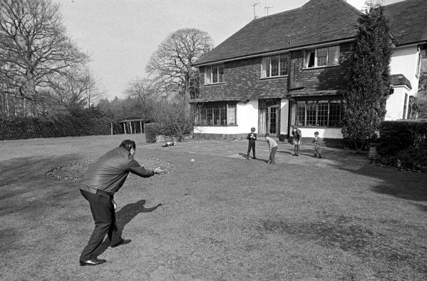 Jack Brabham playing cricket with his children in the garden of his houseSurrey, England, 1970