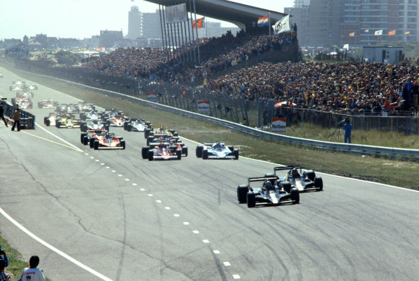 Zandvoort, Holland. 25-27 August 1978. Mario Andretti (Lotus 79-Ford), 1st position, leads Ronnie Peterson (Lotus 79-Ford), 2nd position, at the start, action.  World Copyright: LAT Photographic. Ref: 78HOL31