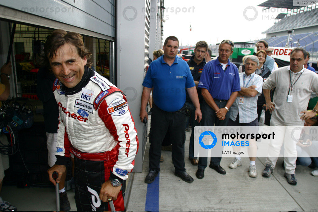 2003 ChampCar World Series, Eurospeedway, Lausitz, Germany. 10-11 May 2003.Alex Zanardi smiling after he has just lapped the Eurospeedway in a modified ChampCar.Photo: Gavin Lawrence/LAT Photographic