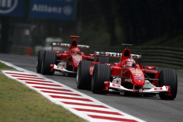 2004 Italian Grand Prix - Sunday Race,Monza, Italy. 12th September 2004 Race winner Rubens Barrichello, Ferrari F2004, leads teammate Michael Schumacher, actionWorld Copyright: Steve Etherington/LAT Photographic ref: Digital Image Only
