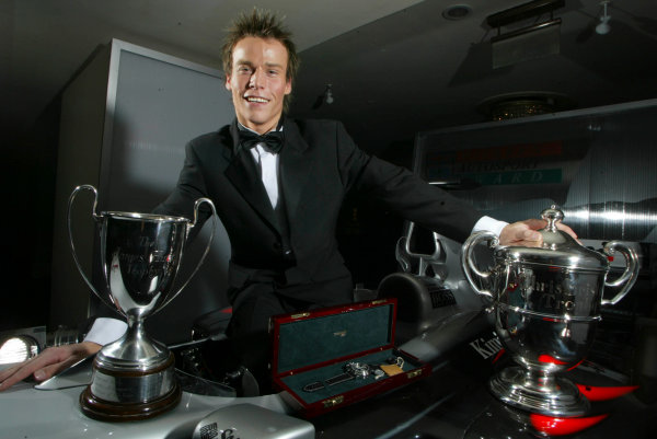 2003 AUTOSPORT AWARDS, The Grosvenor, London. 7th December 2003.McLaren Autosport Young driver, Alex Lloyd shows off his prizes.Photo: Peter Spinney/LAT PhotographicRef: Digital Image only