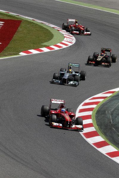 Circuit de Catalunya, Barcelona, Spain 12th May 2013 Fernando Alonso, Ferrari F138, leads Lewis Hamilton, Mercedes W04, Kimi Raikkonen, Lotus E21 Renault, and Felipe Massa, Ferrari F138.  Photo: Andrew Ferraro/LAT Photographic ref: Digital Image _79P4804