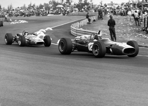 1967 Mexican Grand Prix.Mexico City, Mexico. 22 October 1967.Jonathan Williams, Ferrari 312, 8th position, leads Jean-Pierre Beltoise, Matra MS7-Cosworth, 7th position, action.World Copyright: LAT PhotographicRef: Motor b&w print