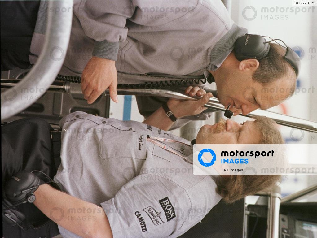 1998 French Grand Prix.Magny-Cours, Nevers, France.26-28 June 1998.McLaren Mercedes-Benz boss Ron Dennis with Norbert Haug of Daimler-Benz Motorsport.World Copyright - Charles Coates/LAT Photographic