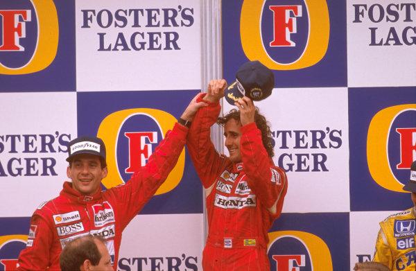 Adelaide, Australia.11-13 November 1988.Ayrton Senna congratulates Alain Prost (both McLaren Honda) on the podium.Ref-88 AUS 11.World Copyright - LAT Photographic