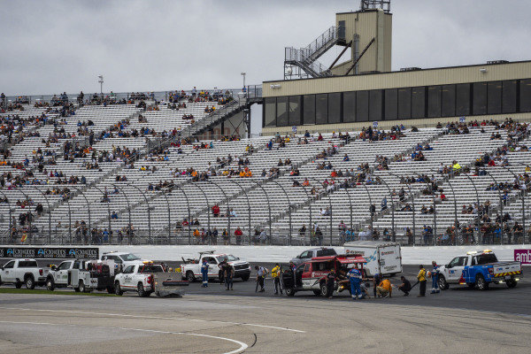 NASCAR and NHMS personnel treat water weepers before the race begins