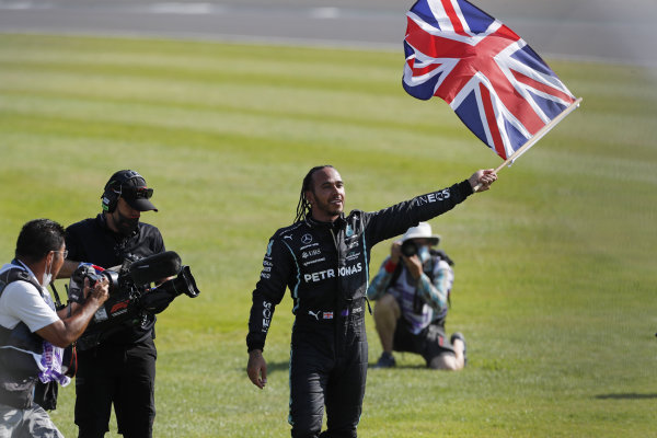 Sir Lewis Hamilton, Mercedes, 1st position, flies the Union flag in celebration after the race