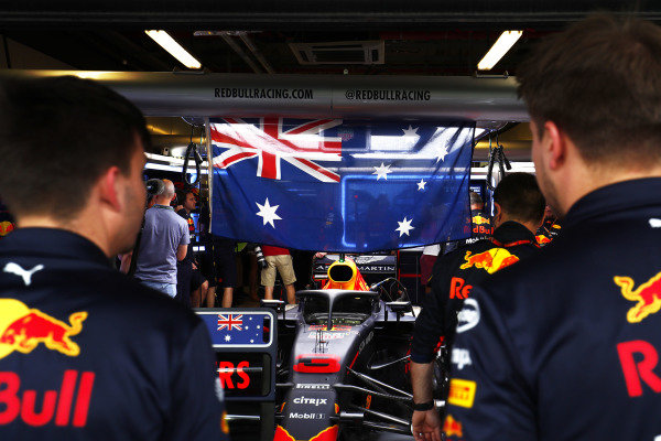 The car of Daniel Ricciardo, Red Bull Racing RB14 in the garage with an Australian flag
