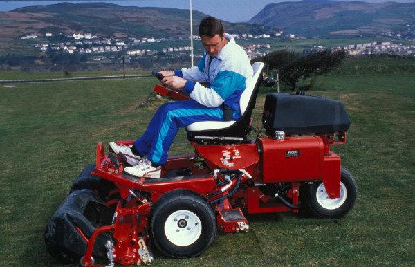 Isle of Man, United Kingdon. 18/4/1989. Nigel Mansell cuts the grass on his lawnmower