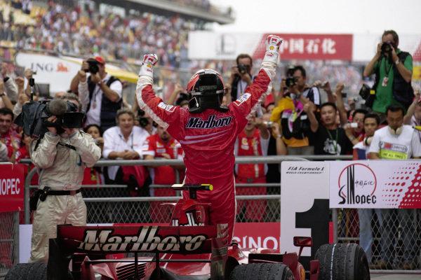 Kimi Räikkönen celebrates victory in parc fermé.