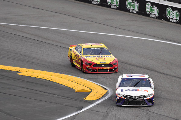 #11: Denny Hamlin, Joe Gibbs Racing, Toyota Camry FedEx Express and #22: Joey Logano, Team Penske, Ford Mustang Shell Pennzoil