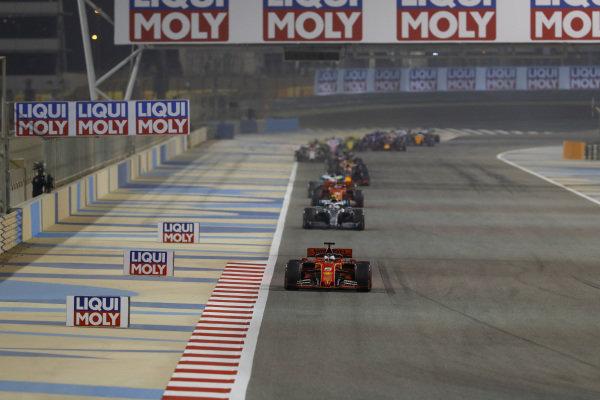 Sebastian Vettel, Ferrari SF90, leads Valtteri Bottas, Mercedes AMG W10, and Charles Leclerc, Ferrari SF90