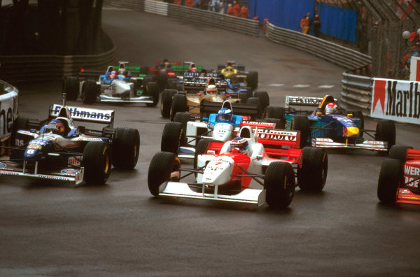 Monte Carlo, Monaco.16-19 May 1996.Jacques Villeneuve (Williams FW18 Renault) dives through the inside of Mika Hakkinen (McLaren MP4/11B Mercedes) at Ste. Devote with Mika Salo (Tyrrell 024 Yamaha) behind at the start.Ref-96 MON 09.World Copyright - LAT Photographic