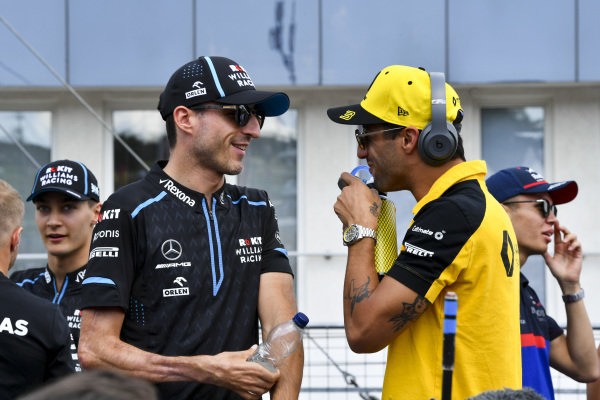 Robert Kubica, Williams Racing, talks with Daniel Ricciardo, Renault F1 Team