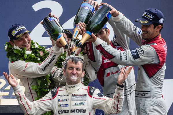 LMP1 podium: class and overalll winners #2 Porsche Team Porsche 919 Hybrid: Romain Dumas takes a champagne shower