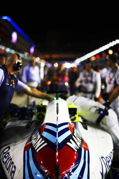 Mechanics attend to Lance Stroll, Williams Racing, on the grid.