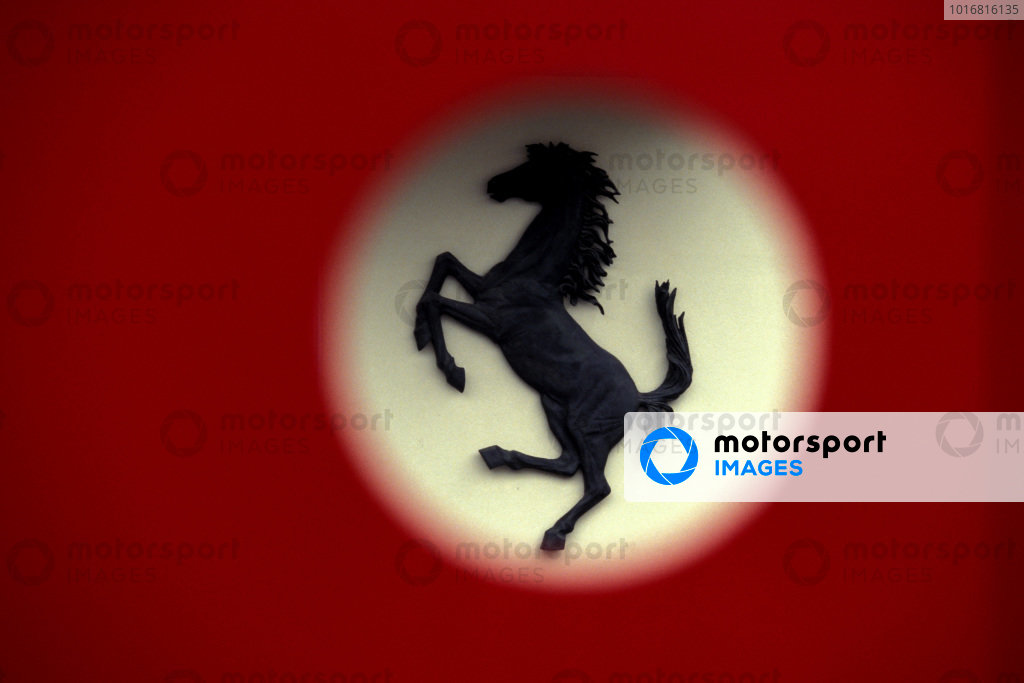 The famous prancing horse logo of Ferrari, seen through a door at the old entrance of Ferrari Sport Management (GES - Gestione Sportiva Ferrari).