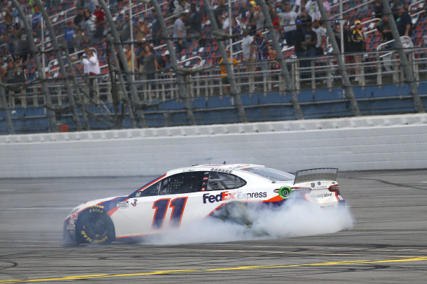 #11: Denny Hamlin, Joe Gibbs Racing, Toyota Camry FedEx Express celebrates his win with a burnout