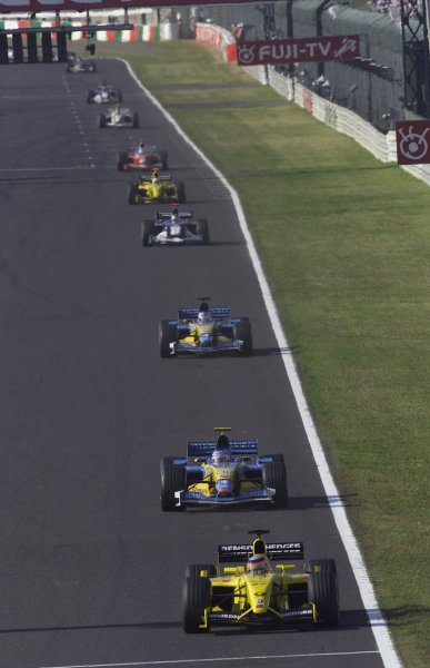 2002 Japanese Grand Prix.Suzuka, Japan. 11-13 October 2002.Takuma Sato (Jordan EJ12 Honda) followed by Jarno Trulli and Jenson Button (both Renault R202's).World Copyright - LAT Photographic/Steve Etheringtonref: Digital Image Only