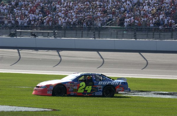 2002 NASCAR,Kansas City,Ks. Sept 26-29, 2002 USA -Jeff Gordon spins through the grass after his win,Copyright-Robt LeSieur2002LAT Photographic