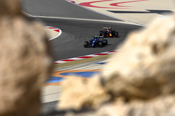 Esteban Ocon, Alpine A521, leads Max Verstappen, Red Bull Racing RB16B