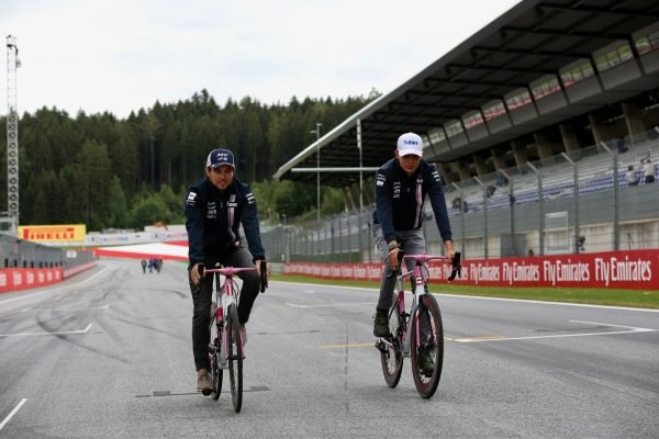 Sergio Perez (MEX) Force India and Esteban Ocon (FRA) Force India F1 with Wyndy Milla bikes
