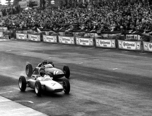 Race winner Graham Hill (GBR) BRM P57 attempts to overtake the then race leader and overall third place finisher Dan Gurney (USA) Porsche 804. German Grand Prix, Nurburgring, 5 August 1962.