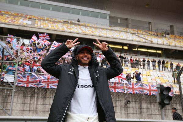 Shanghai International Circuit, Shanghai, China.  Sunday 09 April 2017.  Lewis Hamilton, Mercedes AMG, with fans in the grandstand behind. World Copyright: Charles Coates/LAT Images  ref: Digital Image AN7T0916