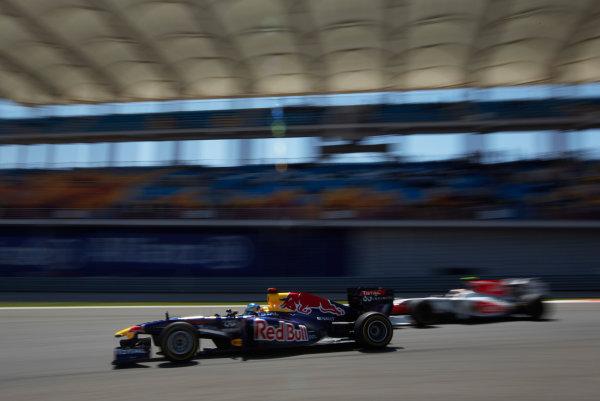 Istanbul Motor Park, Istanbul, Turkey 7th May 2011 Sebastian Vettel, Red Bull Racing RB7 Renault, passes Vitantonio Liuzzi, HRT F111 Cosworth. Action.  World Copyright: Steve Etherington/LAT Photographic ref: Digital Image SNE22178