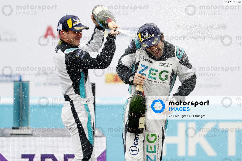 PRO class winner Bryan Sellers (USA), Rahal Letterman Lanigan Racing sprays 3rd position Sérgio Jimenez (BRA), Jaguar Brazil Racing with champagne