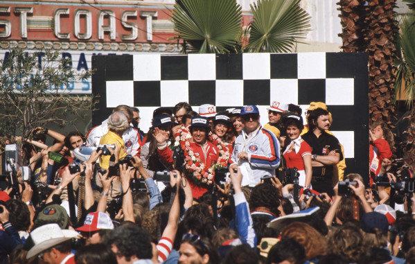 1977 United States Grand Prix West.Long Beach, California, USA.1-3 April 1977.Mario Andretti (Team Lotus) 1st position on the podium.World Copyright - LAT Photographic