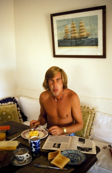 James Hunt (GBR) does not like interuptions whilst eating his breakfast!