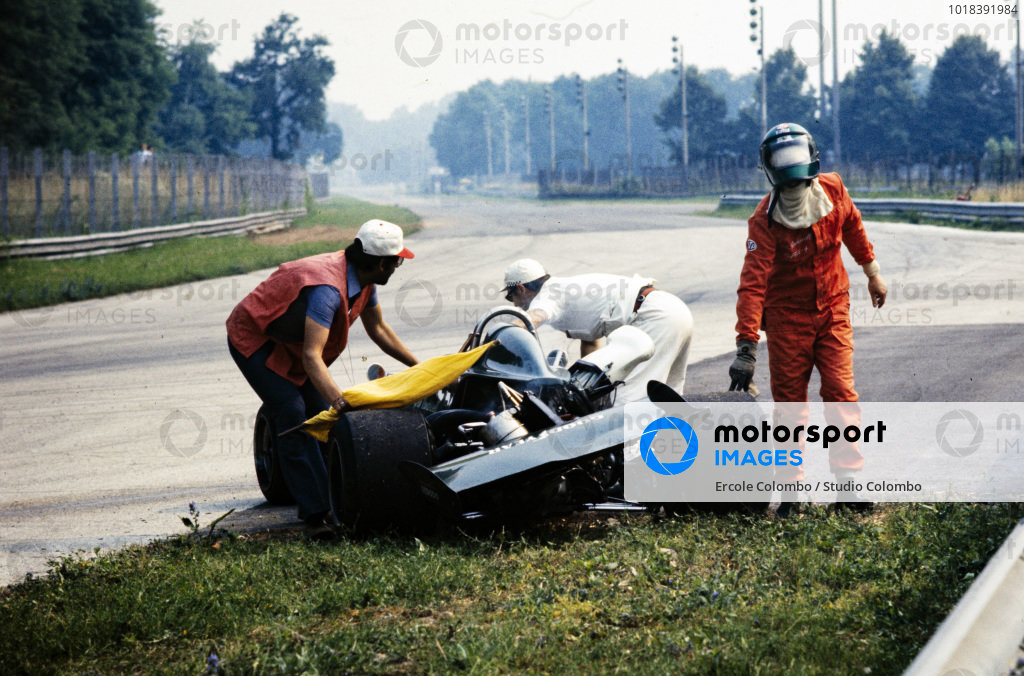 Colin Vandervell walks away from his March 732 BMW. Marshals recover the car.