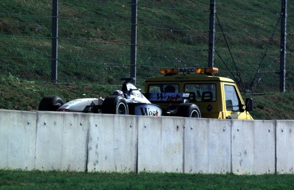 1998 Spanish Grand Prix.Catalunya, Barcelona, Spain.8-10 May 1998.David Coulthard (McLaren MP4/13 Mercedes-Benz) remains in his car after breaking down as instructed.World Copyright - Charles Coates/LAT Photographic