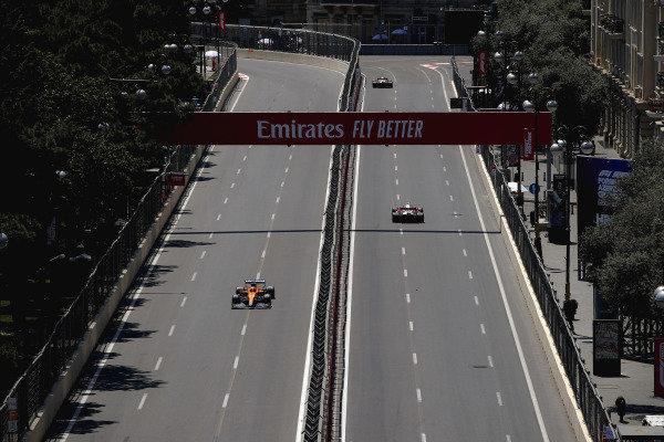 Antonio Giovinazzi, Alfa Romeo Racing C41, leads Daniel Ricciardo, McLaren MCL35M