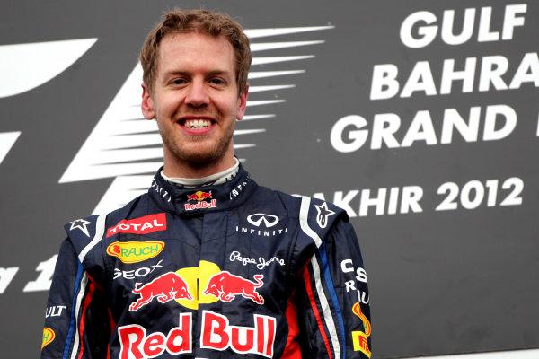 Bahrain International Circuit, Sakhir, Bahrain22nd April 2012Sebastian Vettel, Red Bull Racing, 1st position, celebrates on the podium.World Copyright: Andy Hone/LAT Photographicref: Digital Image HONY8620