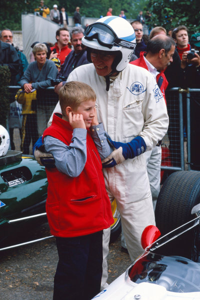 Goodwood House, East Sussex, England. 23-25 June 2000. John Surtees with son, Henry with the Honda, portrait. World Copyright: Jeff Bloxham/LAT Photographic.
